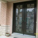 Exterior Doors-Woodgrain Double Doors Fiberglass Juliate Iron Art Design with Multi Point Locks by windows and doors toronto