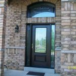 Wood grain Door Fiberglass with Stain Glass Design & Matching Arch Transom Installed by windows and doors toronto in Aurora