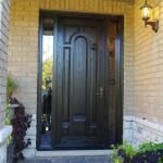 Wood grain Door, Single Solid front Door with 2 Iron Art Side Panel Lites Installed by Windows and Doors Toronto in Brampton