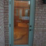 Flush Glazed Smooth Door installation by Windows and Doors Toronto