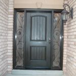 Rustic Door, Single Fiberglass Solid Rustic Door With 2 Iron Art SIde Panel Installed by Windows and Doors Toronto in Woodbridge Ontario