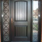 Rustic Door, Single Solid Fiberglass Door with 2 side lights and Iron Art installed by Windows and Doors Toronto