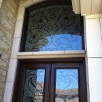 Wrought Iron Woodgrain Fiberglass Double Doors with Iron Art Transom Installed in Richmond Hill by Windows and Doors Toronto