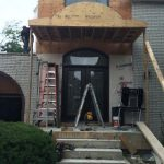 Fiberglass Woodgrain Doors with Wrought Iron Design & Transom & Frosted Glass installed in Toronto by Widows and Doors Toronto