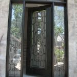 Wood Grain Doors-Single Fiberglass Woodgrain Glass Design Front Door with 2 Iron Art Side Lites and Matching Arch Transom Installed by Windows and Doors Toronto in Aurora
