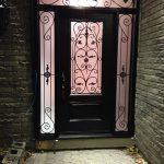 Wrought Iron Fiberglass Door with 2 side lites and transom installed in Richmond Hill by windowsanddoorstoronto.ca