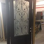 42 inch Oversized Fiberglass Woodgrain With Custom Iron Art and Custom Bottom Panel During Manufacturing by windowsanddoorstoronto.ca