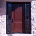 Fiberglass Woodgrain Rustic Front Door with 2 Frosted Side Lites and Iron Art Design installed by windowsanddoorstoronto.ca