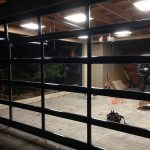 Oversized Aluminum Glass Garage Door Installation in Custom Home in Oakville by windows and doors toronto