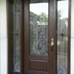 Wrought Iron Fiberglass Doors With 2 Side LItes Installed in Oakville