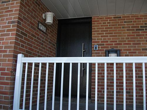 Modern Wood Grain Door Installed by windows and doors toronto