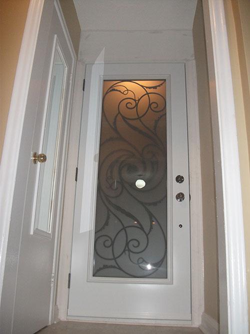 4- Wrought Iron Exterior Door with Iron Art Design Installed by Windows and Doors Toronto