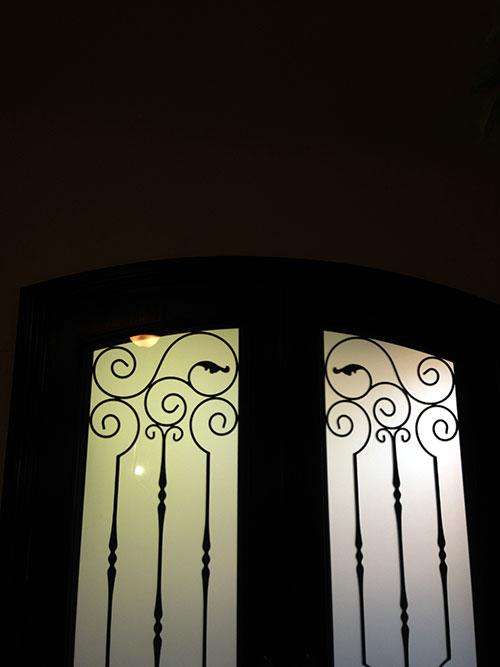 Arch-Fiberglass-Doors-with-Iron-Art-Design-an installed by Windows And Doors Toronto