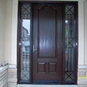 Executive Door, 8-Foot-Fiberglas Sigle-Solid-Door-with-2-Iron-Art-Side-Lights-installed-in-Aurora-Ontario by Windows and Doors Toronto