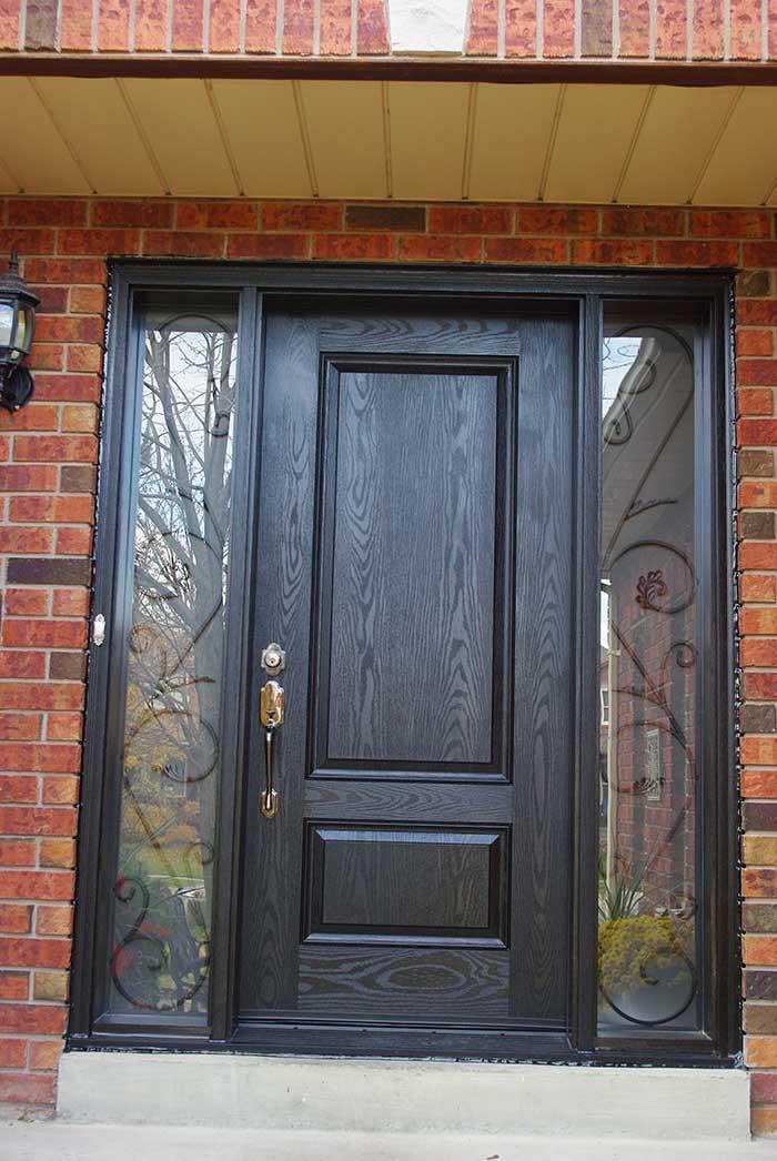 Exterior Door-Single Solid Fiberglass Woodgrain Front Door with 2 Iron art Side Lites Installed by Windows and Doors Toronto in Brampton Ontario