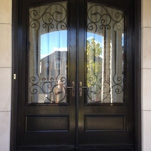 Fiberglass-Arch-Doors-wth-Wrought-Iron-Design-glass-designed-by-Windows And Doors Toronto