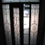 Wood grain Door, Glass Design Front Door with 2 Iron Art Side Lites and Matching Arch Transom Inside View Installed by Windows and Doors Toronto in Aurora