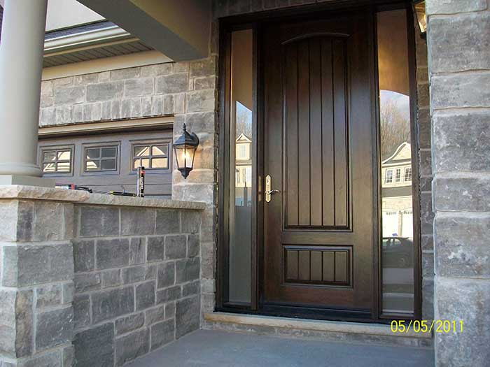 Wood grain Door, with 2 Frosted Side Lites & Multi point Locks installed by Windows and Doors Toronto