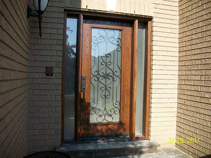 Woodgrain Door, with Paris Design & 2 side Lites Installed by Windows and Doors Toronto in Toronto