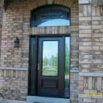 Wood grain Door, with Stain Glass Design & Matching Arch Transom installed by Windows and Doors Toronto