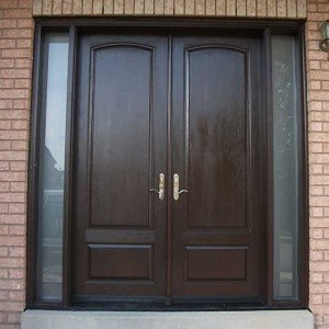 Wood grain Doors, Solid Fiberglass Front Door with Rustic and 2 Iron Art Side Lights Installed by windows and doors toronto in Thornhill Ontario