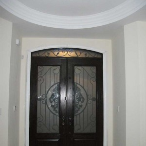 Wood grain Doors, Stained Glass Door with Matching Iron Arch Transom Installed by Windows and Doors Toronto in Oakville - Inside View