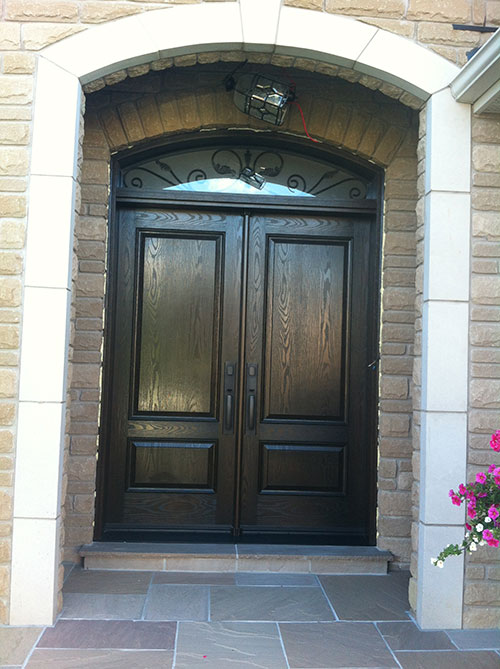 Wood grain Doors with Arch iron Art Transom Installed by Windows and Doors Toronto