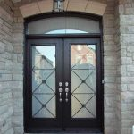 Wood grain Doors with Iron Glass Design & Matching Arch Transom by Windows and Doors Toronto