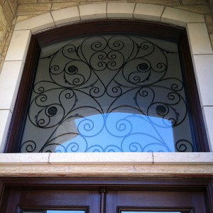 Wood grain Wrought Iron Doors with Iron Art Transom Installed by Windows and Doors Toronto