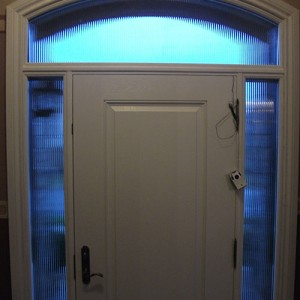 Wood grain door with 2 side lites and arch transom - Inside View by Windows and Doors Toronto