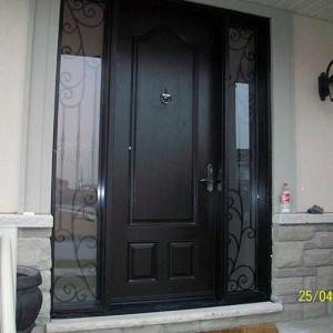 wood grain Door with 2 Iron Art Side Lites installed by Windows and Doors Toronto