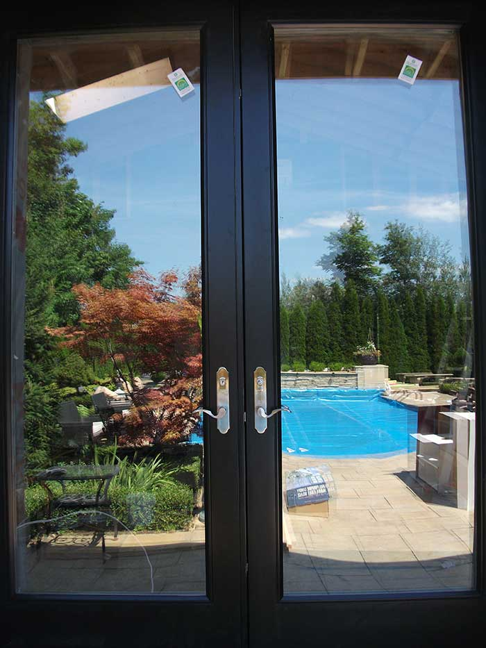 8-Foot-Back-Yard-French-Doors-with-Multi-Point-Locks-Installed- by Windows and Doors Toronto in-Richmondhill