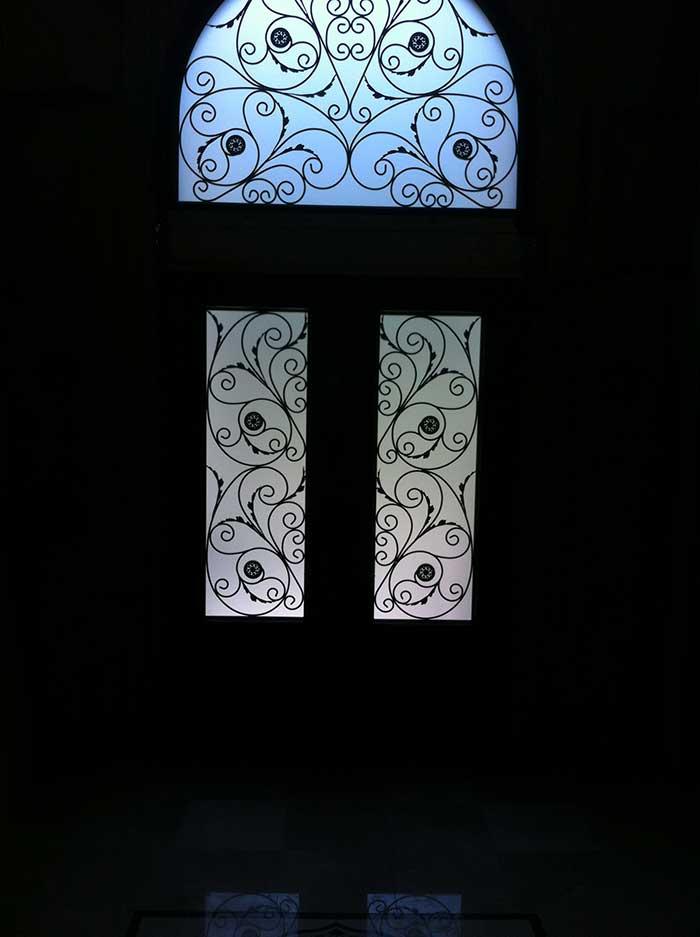 8-Foot Doors, Fiberglass-Milan-design-Front-Door-with-Matching-Iron-Art-Design-Transom-Installed-in-Custom-Build-Home- by Windows and Doors Toronto