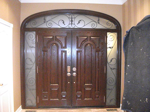 8 Foot Fiberglass Double Doors Parliament Design with 2 Iron Arts Side Lites and Transom, Inside View Installed by Windows and Doors Toronto