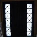 Custom Doors-Double Solid Fiberglass Front Door With 2 Side Lites Iron Art Design Installed by Windows and Doors Toronto in Etobicoke
