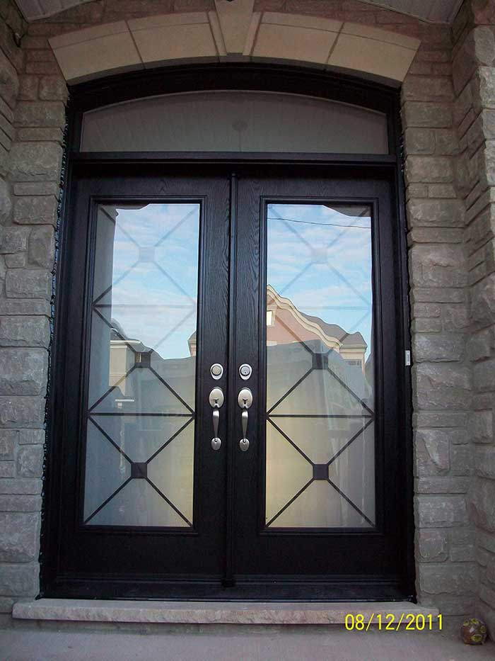 Custom Doors-Fiberglass Woodgrain with Iron Glass Design & Matching Arch Transom Installed by Windows and Doors Toronto in Berrie
