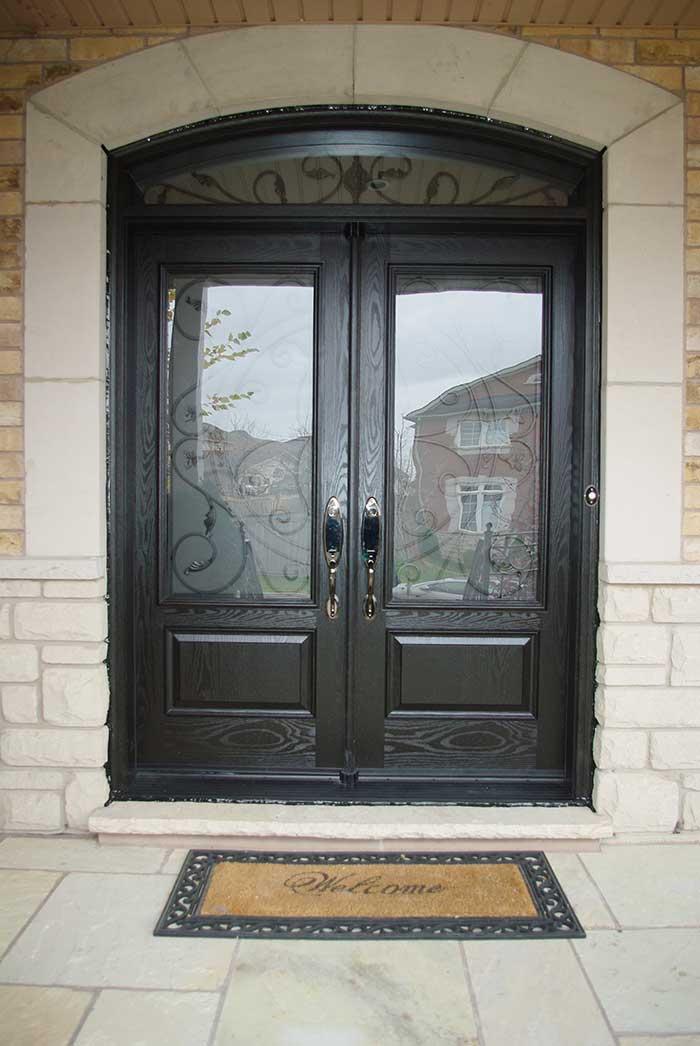 Custom Doors, Woodgrain Fiberglass Double Iron Art Glass Design front Door with Nice Matching Arch ransom Installed by Windows and Doors Toronto in Richmondhill Ontario