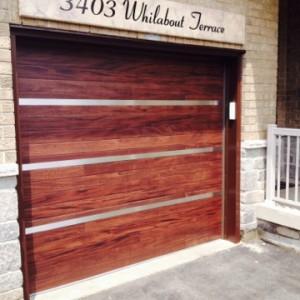 Custom Single Garage Door with Stainless Steel Design installed in Oakville
