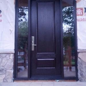 Front Single Fiberglass Executive Door with 2 Side Lites installed in New Construction Custom Home in Burlington by windowsanddoorstoronto.ca