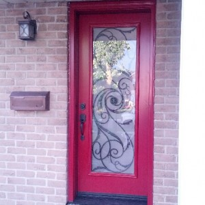 Front Single Entry Door with Wrought Iron Design installed in Brampton by windowsanddoorstoronto.ca