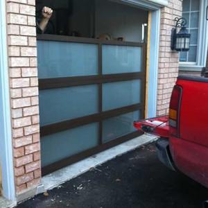 Glass-Design-During-installation-in-Aurora by 8 Foot Fiberglass Garage Door-Panel 9800 Horizontal installaed by Windows and Doors Tor