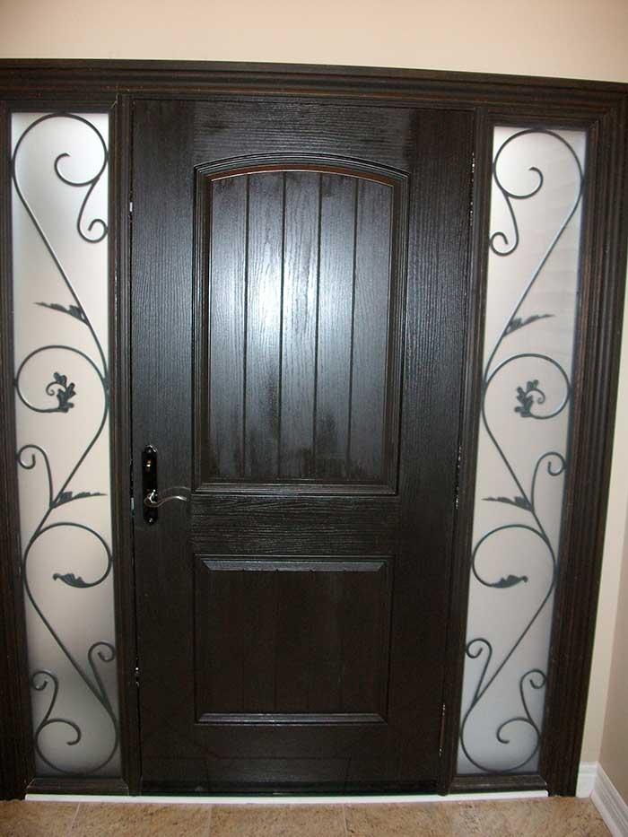Rustic Door, Solid Rustic Door With 2 Iron Art Side Panel Installed by Windows and Doors Toronto in Woodbridge Ontario - (Inside View)