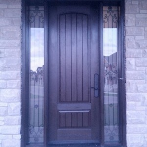 Rustic Fiberglass Door with 2 Wrought Iron Side Lites installed by windowsanddoors.ca in Richmond Hill