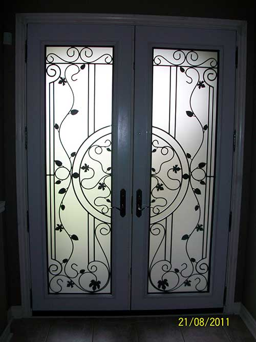 Smooth Doors installed, Wrought Iron with Multi Point Locks Installed by Windows and Doors Toronto
