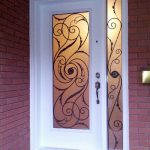 Wrought Iron Design Fiberglass Door with side lite installed in Vuaghan by Windows and Doors Toronto