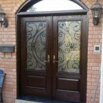Wrought Iron Julieta Design Fiberglass Double Doors with Arch Transom installed in Oshawa by Windows and Doors Toronto