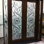 Wrought Iron Serafina Design Double Doors with 2 Iron Art Side Lites Installed by Windows and Doors Toronto