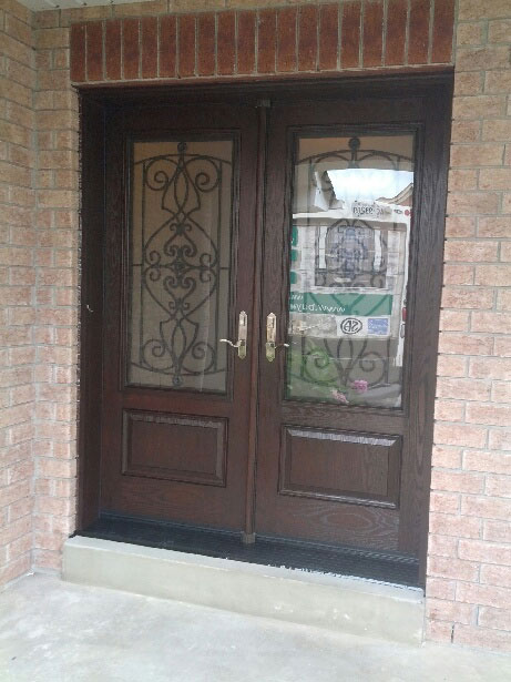 Wrought Iron Woodgrain Fiberglass Double Doors Installed by Windows and Doors Torontoin Thornhill
