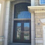 Wrought Iron Woodgrain Fiberglass Double Doors with Nice Iron Art Transom Installed in Richmond Hill by Windows and Doors Toronto