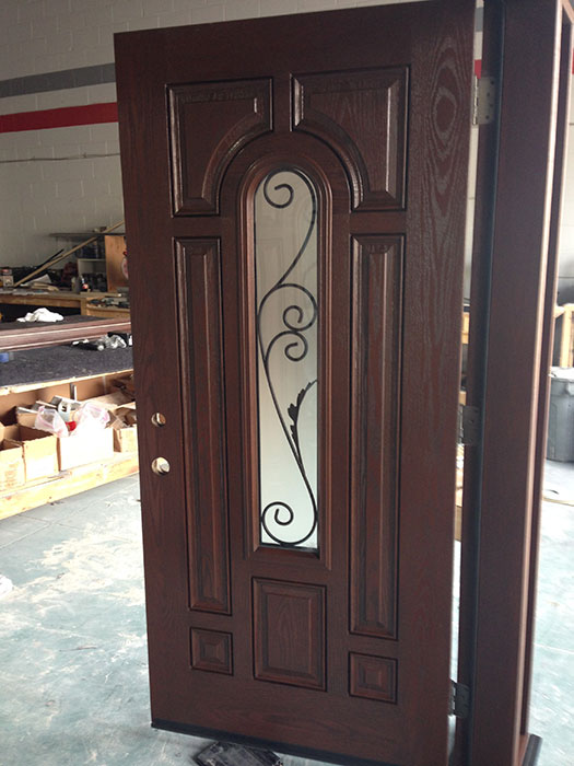 8 Panel Fiberglass Woodgrain Front Doors with Clear Glass Side Lites Iron Art Designs During Manufacturing by windowsanddoorstoronto.ca